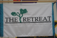 THE RETREAT CORPORATE LOGO FLAG